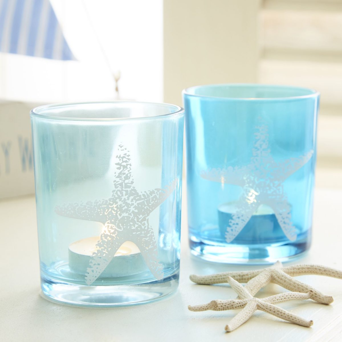 21live-laugh-love-ltd_star-fish-tea-light-holders-pair-1200x1200.jpg