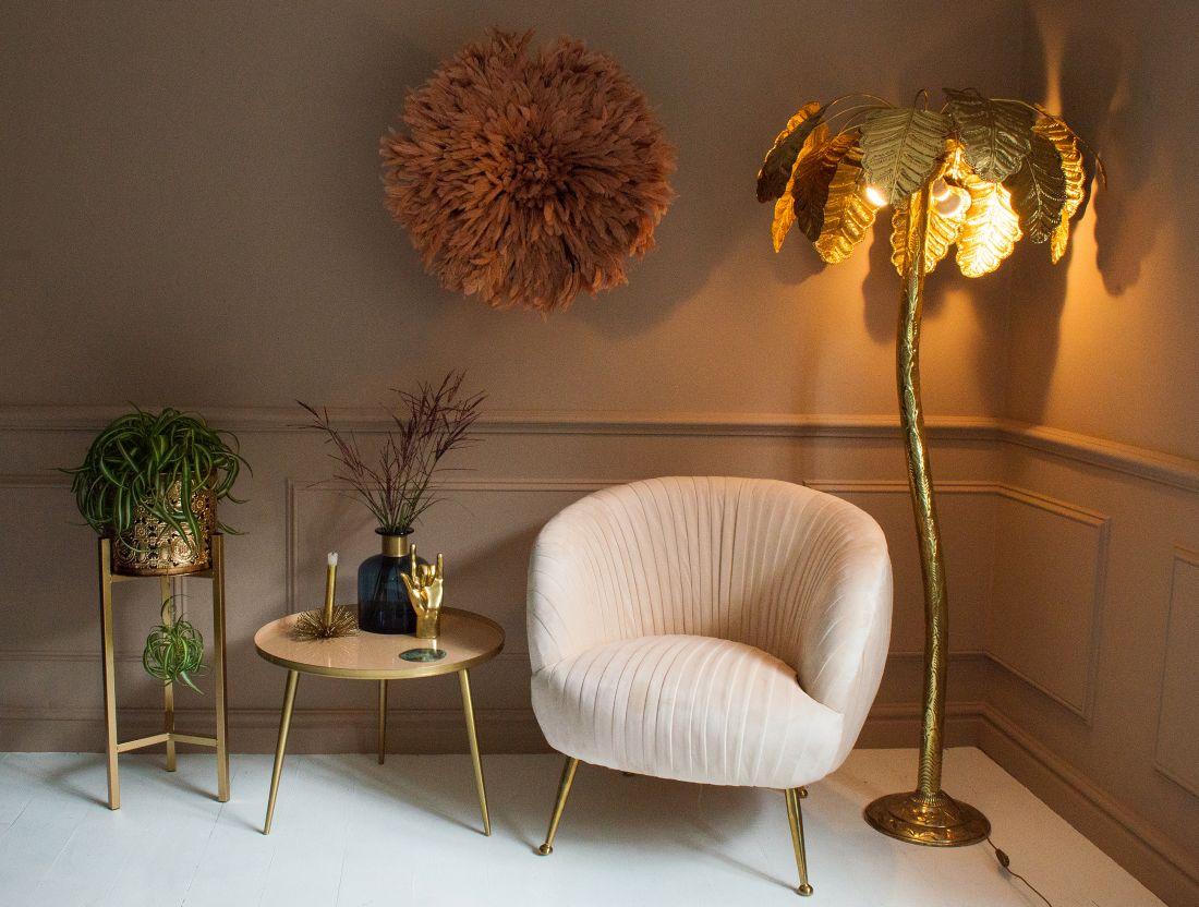 12audenza_marilyn-velvet-armchair-al560.-brass-palm-tree-floor-lamp-al995.-feather-juju-hat-al305.jpg