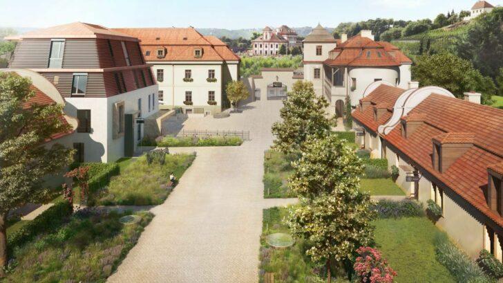 novostavby-v-chateau-troja-residence-navazuji-na-historicke-budovy.-cervena-taska-svetla-omitka-i-zamkova-dlazba-se-postaraji-aby-se-odrazilo-co-nejvice-svetelneho-zareni-a-plochy-se-zbytecne-neohrivaly-728x409.jpg
