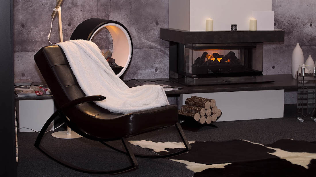 modern interior with rocking chairs and adecorative electric fireplace